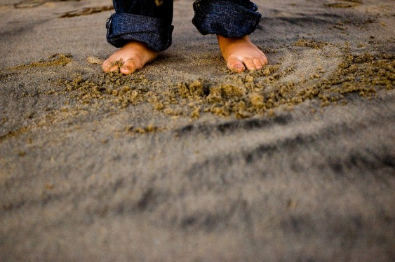 Close-up of Feet in Sand Portrait
