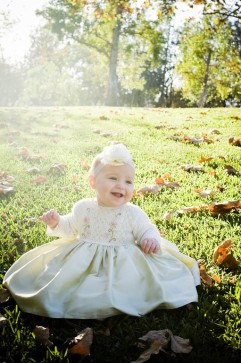Baby in Formal Dress in Field Portrait