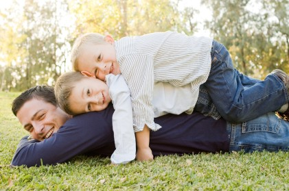 Pile-up of Kids and Dad Portrait