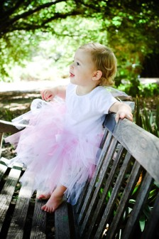 Baby in Pink Tutu on Park Bench Portrait