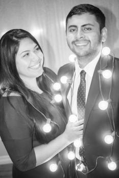 Christmas Lights Hanging on Couple Portrait