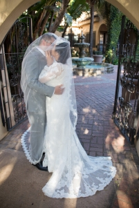 Bride Kissing Groom Under Veil