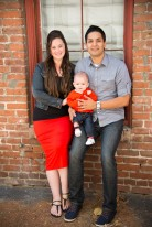 Parents with Son Portrait Against Brick Wall