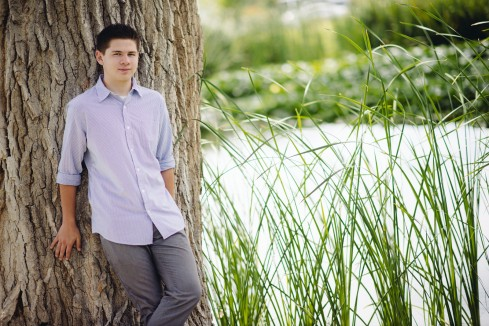 Teenager Guy with Tall Grass and Tree Portrait