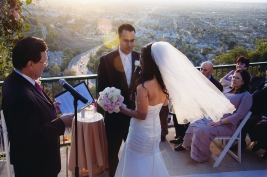 Bride and Groom Sharing Vows with Scenic View