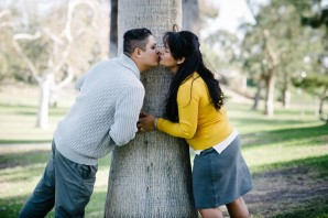 Couple Kissing in Front of Tree Portrait